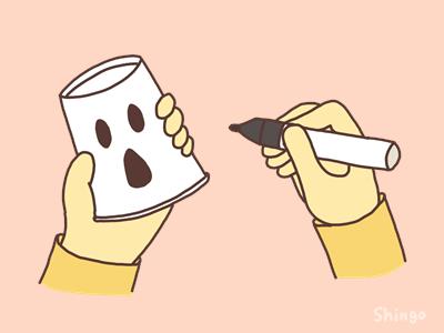 紙コップにオバケの顔を描く