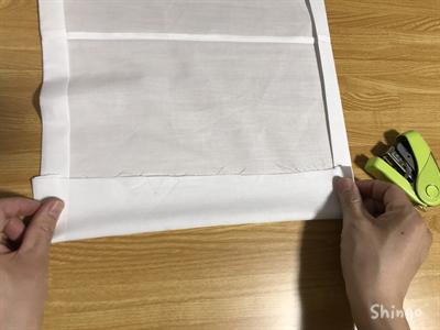 布を折り曲げる